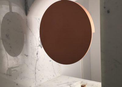 Miroir rond en cuivre suspendu