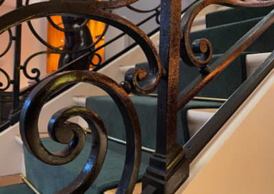 Détail de la rampe en ferronnerie de style Louis XVI